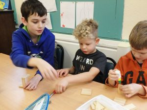 Mixed aged student collaborating and helping each other
